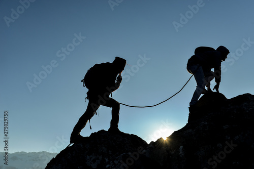 plakat concept of professional two climbers crossing the cliffs
