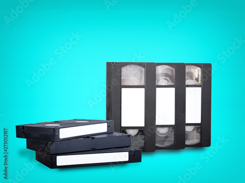 Valokuvatapetti VHS videotapes on a blue background stacked vertically and horizontally