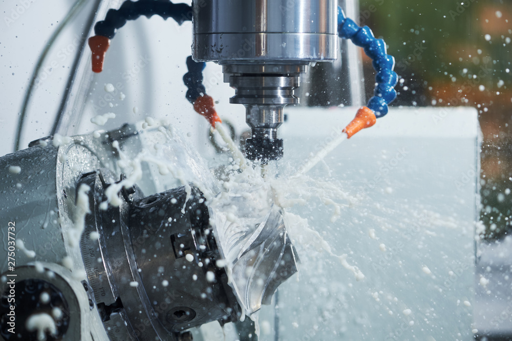 Fototapeta CNC milling machine work. Coolant and lubrication in gear metalwork industry