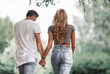 Couple in love walking in park holding hands