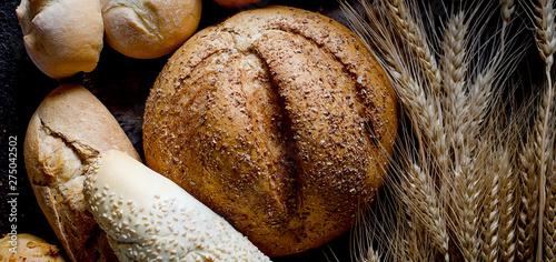 Foto auf AluDibond Brot Assortment of baked goods in black background