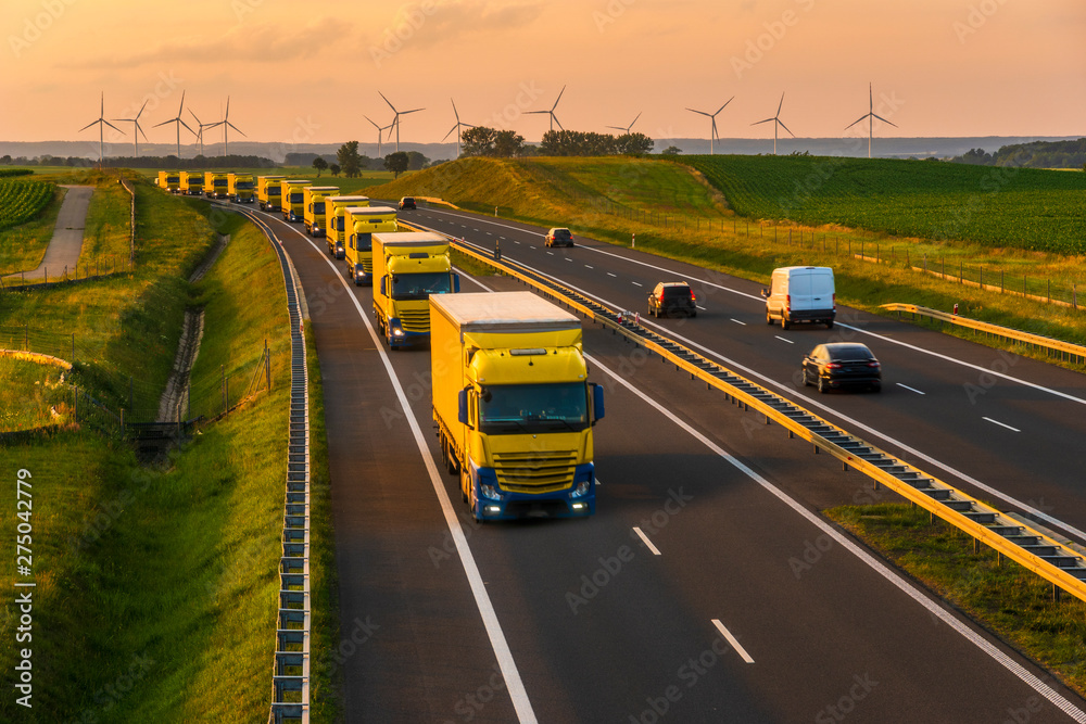 Fototapety, obrazy: intensive highway traffic at sunset - column of trucks on the motorway in Poland