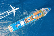 Cruise Ship Liner Sails In The Blue Sea Leaving A Plume On The Surface Of The Water Seascape, And Flying Airplane With A Trail Of Steam. Aerial View Concept Of Travel, Cruises.