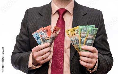 Canvas Prints Countryside Man holding australian dollar banknotes close up