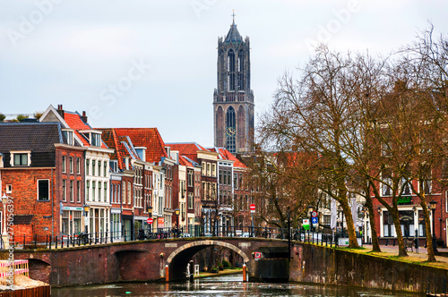 Fotomural View of old town with Dom Tower in Utrecht, Netherlands during the cloudy day