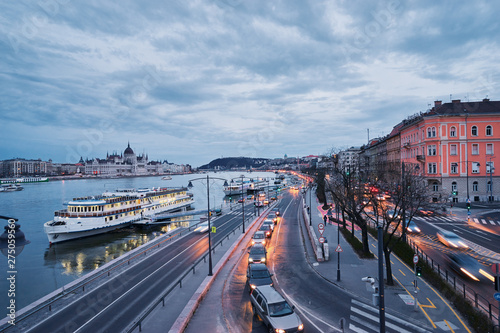 Wall Murals Northern Europe Danube River at blue hour twilight in city of Budapest, Hungary, Cruise and dinner boat near riverside promenade.