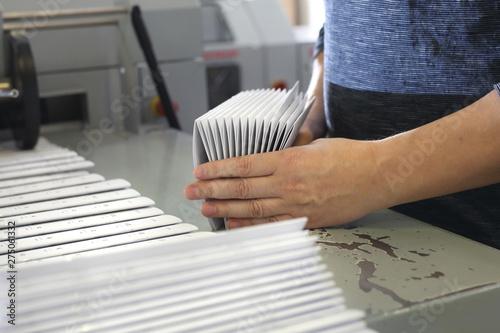 Fototapeta Printing house. Packaging of printed leaflets. Advertising stuff
