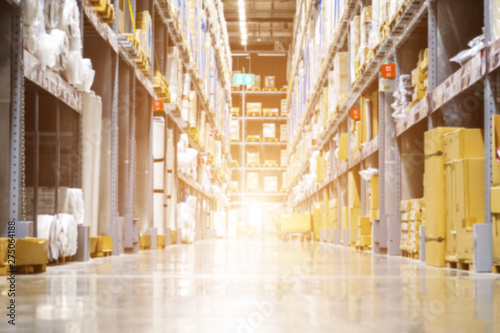 Huge distribution warehouse with high shelves and loaders, Rows of with boxes, Rows of shelves with boxes, Blurred business background, Blurred business background.