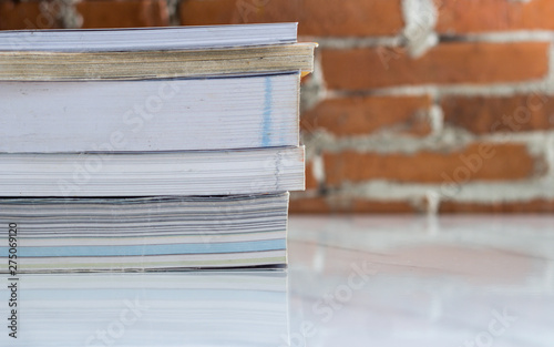 Stack of hardcover books on table against marble background, space for text Fototapet