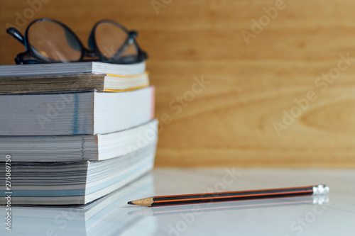 Fotografie, Tablou Stack of hardcover books on table against marble background, space for text