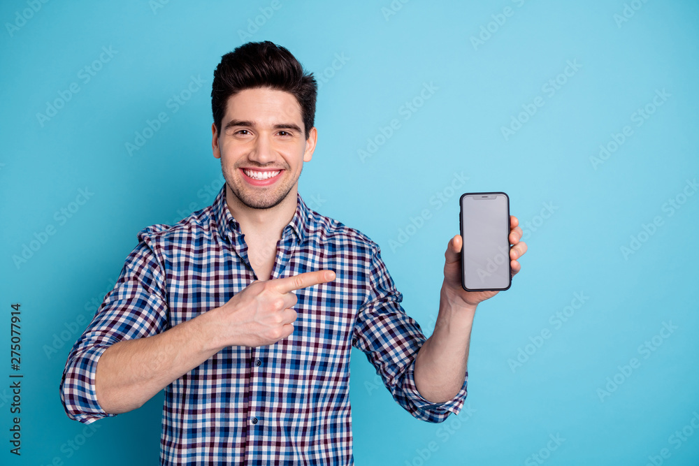 Fototapety, obrazy: Photo portrait of confident positive optimistic cheerful with beaming toothy smile agent salesman trader freelancer businessman holding cellular in hand arm isolated pastel background