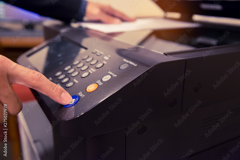 Fototapety, obrazy: Bussiness man Hand press button on panel of printer, printer scanner laser office copy machine supplies start concept.
