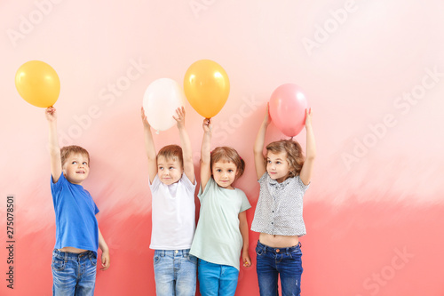Fotografie, Obraz  Cute little children with air balloons on color background