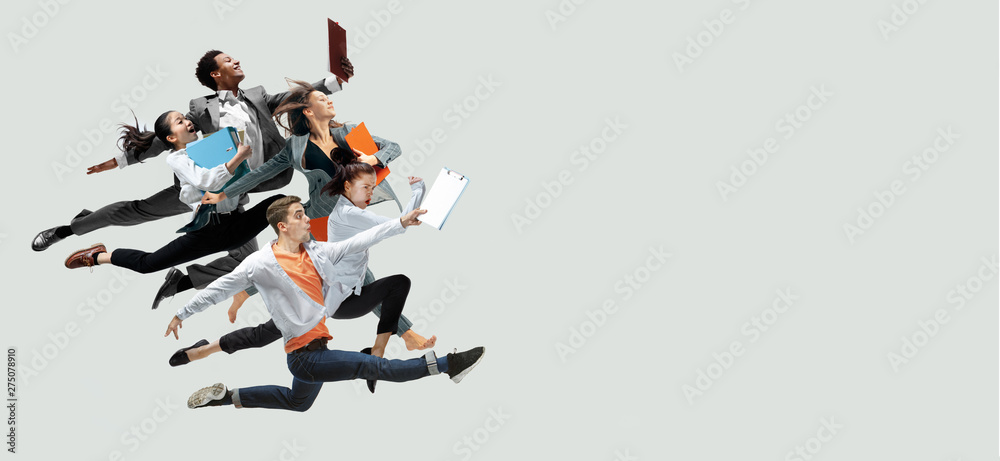 Fototapety, obrazy: Happy office workers jumping and dancing in casual clothes or suit with folders isolated on studio background. Business, start-up, working open-space, motion and action concept. Creative collage.
