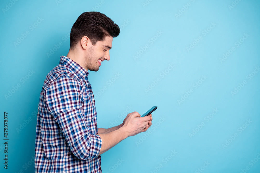 Fototapety, obrazy: Side profile half turned photo portrait of confident positive optimistic excited involved interested carefree generation y guy holding digital telephone in hand leaving share post isolated background