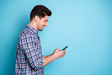 Side Profile Half Turned Photo Portrait Of Confident Positive Optimistic Excited Involved Interested Carefree Generation Y Guy Holding Digital Telephone In Hand Leaving Share Post Isolated Background