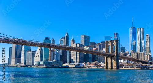Fototapeten New York Famous Skyline of downtown New York City, Brooklin Bridge and Manhattan with skyscrapers illuminated over East River panorama. New York, USA