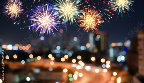 Canvas Prints Countryside abstract group of colorful multi fireworks explosion on blur night cityscape town background with text for fourth of july celebrate concept