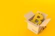 Leinwanddruck Bild - Bitcoin symbol inside cardboard box
