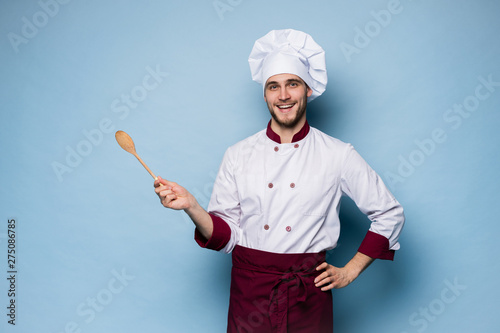 Portrait of positive toothy chef cook in beret, white outfit having tools in crossed arms looking at camera Fotobehang