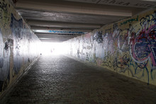 Pedestrian Crossing Tunnel, Dark And Long Underground Passage With Light