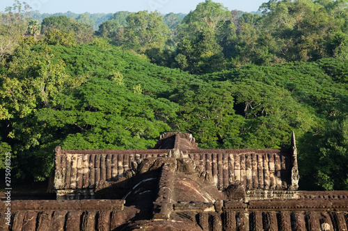 Fragment of an old Hindu temple in the forests of Cambodia. Abandoned building in the forest.