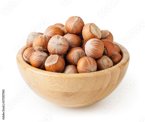 Valokuvatapetti Hazelnuts in wooden bowl isolated on white background with clipping path