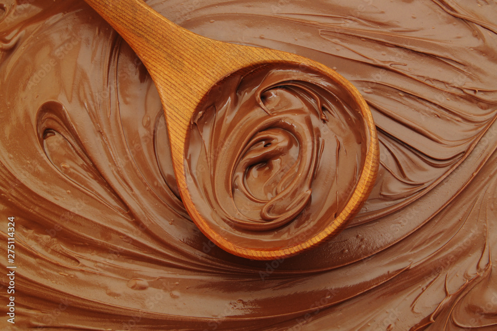 Chocolate spread with wooden spoon