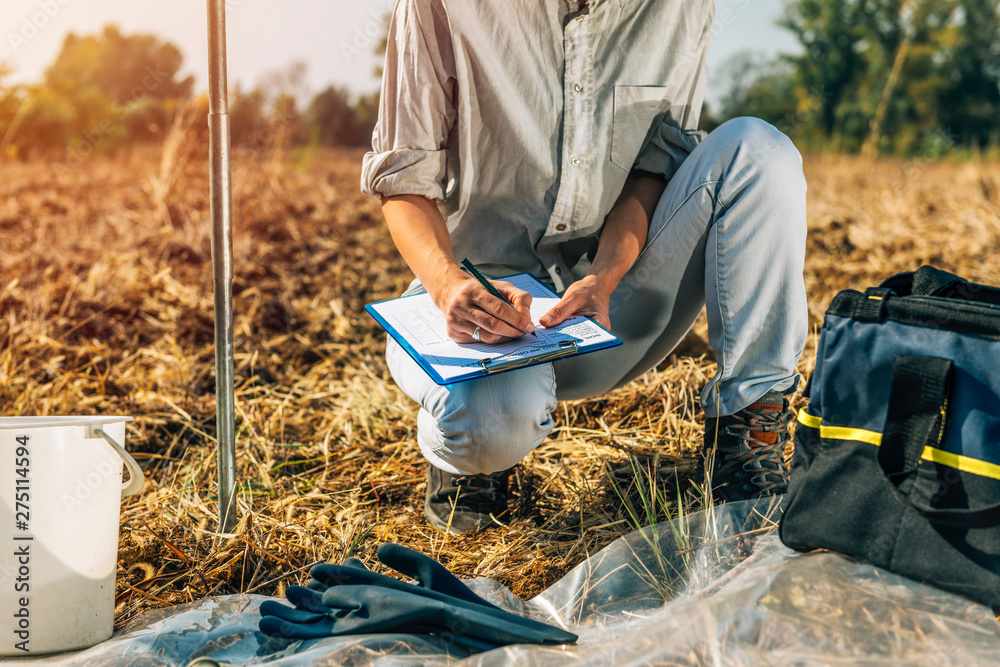 Fototapety, obrazy: Soil Testing. Female Agronomists Taking Notes Outdoor