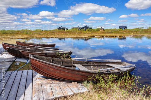 Fototapeta Rowing boats on a jetty by a lake