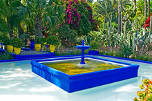 A View Of A Water Garden In Marrakech With Water Feature And Colourful Containers, Cactus And Bougainvillea