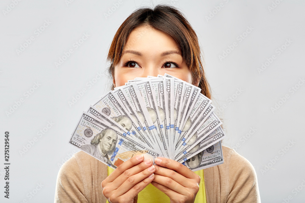 Fototapety, obrazy: people, ethnicity and portrait concept - happy asian young woman holding hundreds of dollar money banknotes over grey background