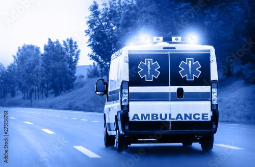 Ambulance van on highway with flashing lights Wallpaper Mural
