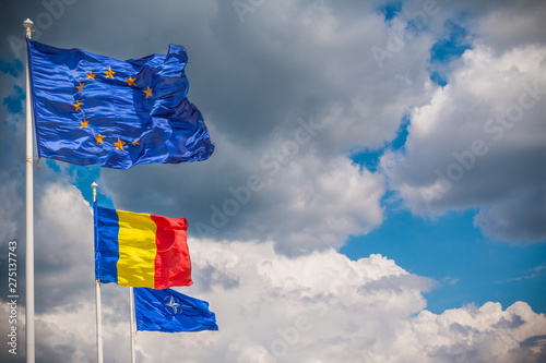 European Union, Romania And NATO Flags Fluttering In The Wind Canvas Print