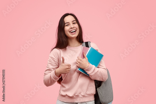 Cheerful student gesturing thumb up Wallpaper Mural