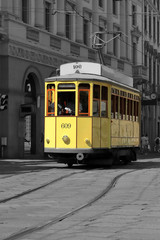 tram giallo a milano in italia, yellow streetcar in the downtown of milan city in italy