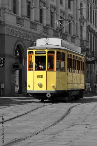 Fototapeta tram giallo a milano in italia, yellow streetcar in the downtown of milan city in italy  obraz na płótnie