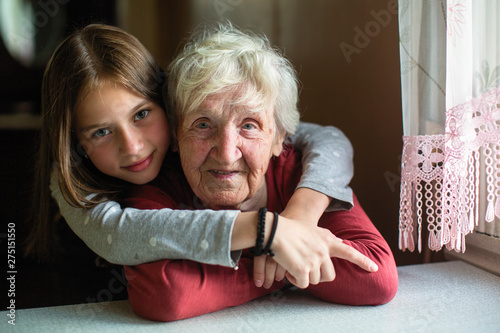 Obraz Portraits of the little girl and her old grandmother. - fototapety do salonu