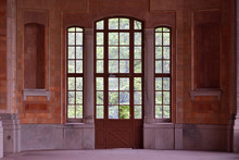 Beautiful And Old Large Full-wall Glass Window With A Door And Access To The Garden. European Architecture