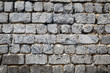 Textural background, a wall of gray old stones.