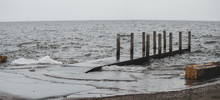 Choppy Water And Small Waves At The Pier On A Cold And Windy Day