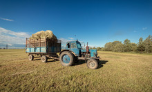 Tractor Collects Hay In The Fi...