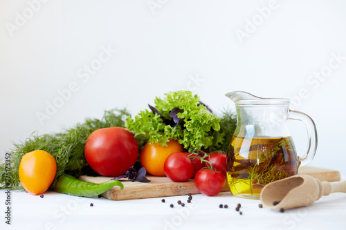 Obraz Composition with vegetables and spices on a table on a white background - fototapety do salonu