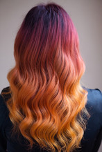 Woman With Bright Color Dyed Long Curly Hair