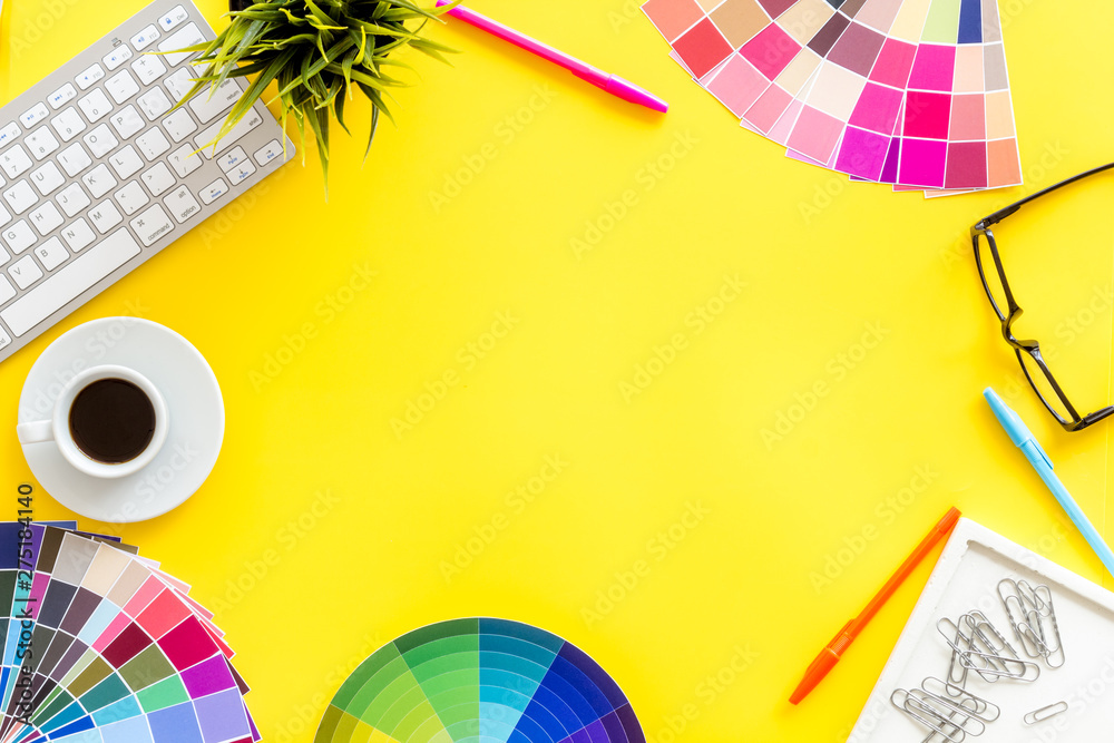 Fototapeta Pallet, keyboard, glasses, cup of coffee and tools for designer work on yellow desk background top view copyspace frame