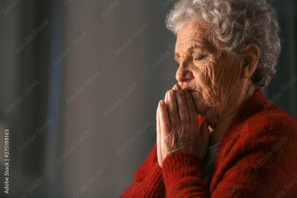 Fototapety, obrazy: Senior woman praying to God at night