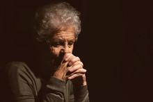 Senior Woman Praying To God On...