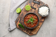 Bowls With Tasty Chili Con Carne And Rice On Grey Background