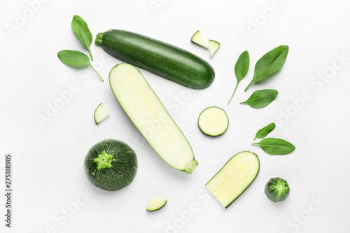 Fototapeta Cut zucchini squashes on white background obraz