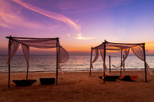 The White Beach Tents And Beach Chairs On Beautiful Beach At Sunset Time Twilight Sky Background.
